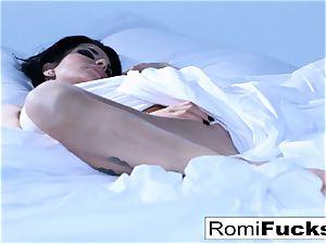 Solo joy on the sofa with the busty porn industry star Romi Rain