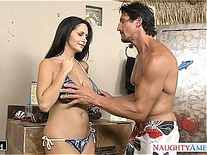Ava Addams places his pecker inbetween her huge globes