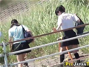 nubile asians urinating