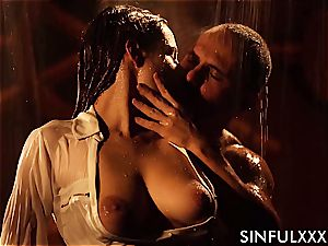 screwing a big-chested lovely while the water runs in rivulets down her gentle flesh