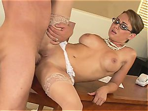Holly West works rigid to get that lollipop jizz all over her uber-sexy glasses