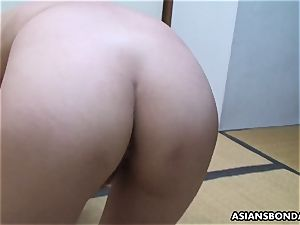 asian sadomasochist toys her furry poon while being caned