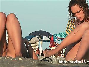 bare beach voyeur shoots cuties with a hidden web cam