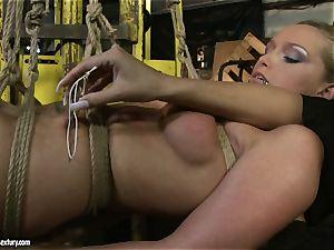 Kathia Nobili and Mandy Bright body binding with strap
