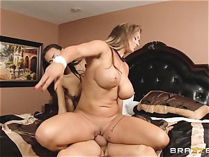 Eva Notty demonstrates her stepdaughter Janice Griffith how to satiate a man sausage